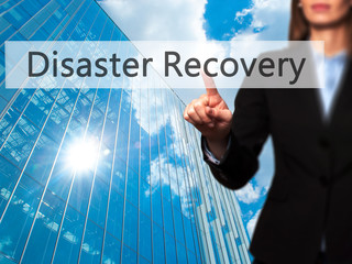 Disaster Recovery - Business woman point finger on push touch screen and pressing digital virtual button.