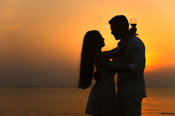 silhouette of a romantic couple on beauty sunset