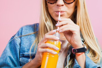 Beautiful blonde woman drink orange juice
