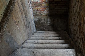 Keuken foto achterwand Trappen old stairs leading a way down into the dark cellar