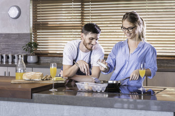 breakfast preparation  kitchen cooking happy young couple