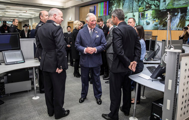 Britain's Prince Charles and Camilla the Duchess of Cornwall meet members of the emergency services who were on duty the night of the attack at London Bridge and Borough Market during a visit to the Central Communications Command in London