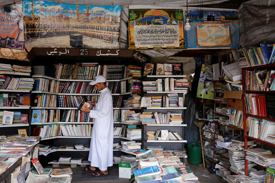 A man reads a book at a bookshop in Bab Doukkala in the city of Marrakech