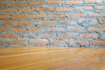 Empty wooden floor or table over brick wall background, for product display montage