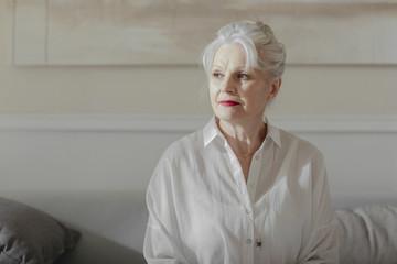 Portrait of pretty grey-haired senior Caucasian woman.