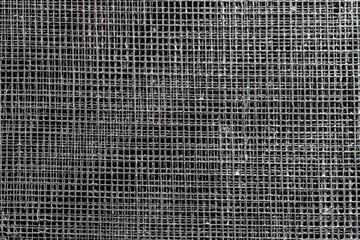 wire mesh on dark. Metal background.