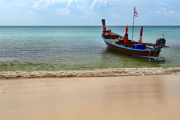 Thai traditional boat on the beach on the roads