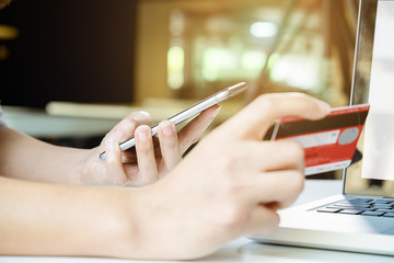 asian young woman hands holding laptop smart phone and using credit card Online shopping.Online shopping concept