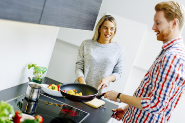 Young couple preparing vegetables food for lunch
