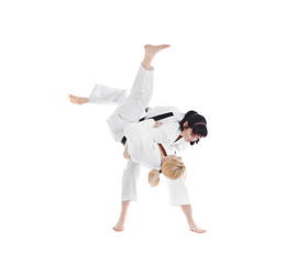 Foto op Aluminium Vechtsport Young sporty women practicing martial arts on white background