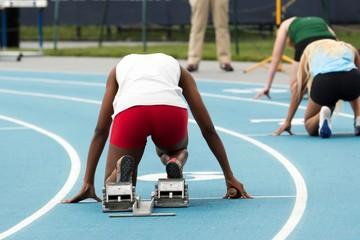 Sprinter in the starting blocks