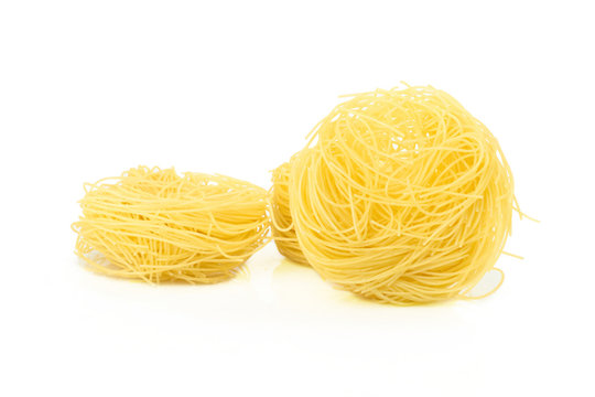 Raw Angel Hair Pasta isolated on white background