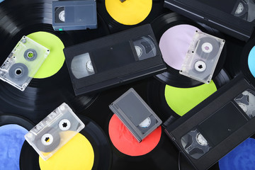 Vinyl records with video and music cassette tapes