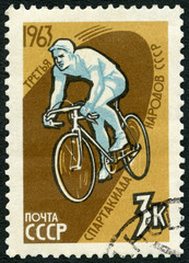 USSR - CIRCA 1963: A stamp printed in USSR shows Bicyclist, series 3rd Spartacist Games