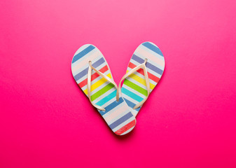 Above view at multicolor striped flip flops