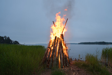 Midsummer bonfire in the night.