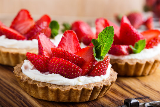 Strawberry shortcake pies on rustic wooden table