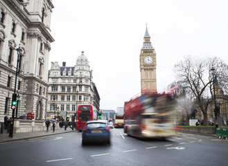 Traffic in Central London city, long exposure photo of red bus in motion, Big Ben in background