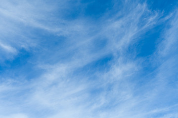 Bright blue sky with white clouds in a horizontal orientation