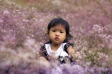 Portrait Of A Little Girl Amid Flowers