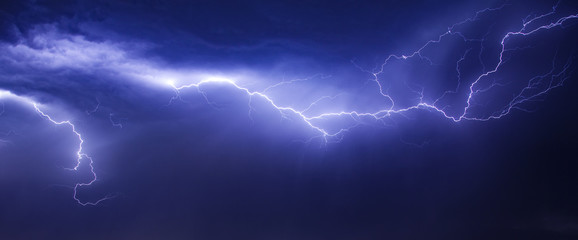 beautiul and dramatic lightning in sky