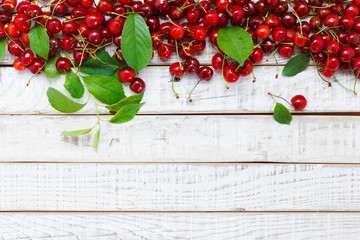 Fruit background, cherry on wooden table