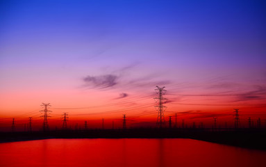High voltage towers, silhouette in the evening