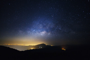 Milky Way Galaxy with light city at Doi inthanon Chiang mai, Thailand.Long exposure photograph.With grain