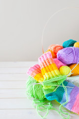 Closeup of basket with colorful yarn clews. Concept of freelance creative working and happy living