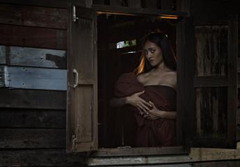 Legendary Thai ghost Mae Nak Phra Khanong,Mae Nak Phra Khanong stood carrying her baby,Thai Ghost concept,Thai traditional uniform dress.