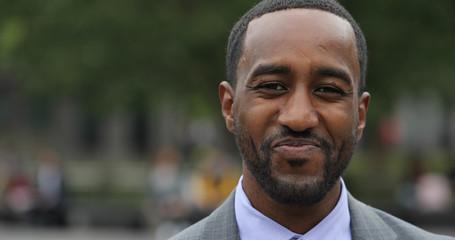 Black business man in city park face portrait smile