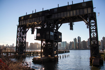iconic gantries of Gantry State Park on East river and Manhattan city
