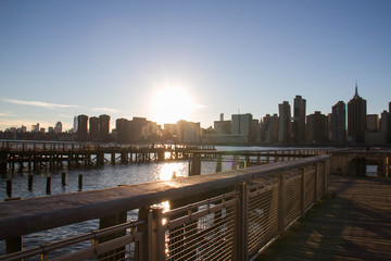 Manhattan city with sunset and pier at Gantry Plaza State Park over the river