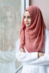 Attractive muslim woman  standing.