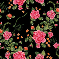 Embroidery traditional seamless pattern with red roses and forget me not. Vector embroidered floral bouquet template with flowers for clothing design.