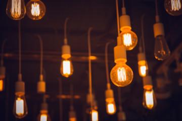 blur hang light blub interior cafe lighting for background.