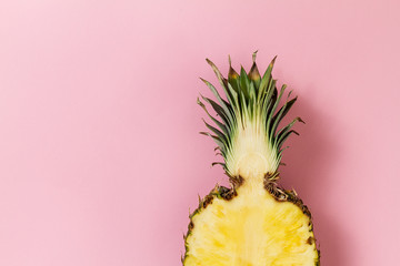 Half slice of beautiful fresh appetizing tasty pineapple on pink background. Top View. Horizontal. Copy Space. Conceptual.