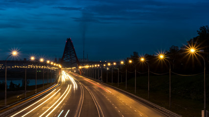 Night road in the city with car lights in Novosibirsk, Russia