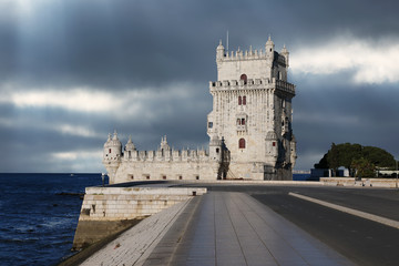 Fototapete - Belem Tower against a dramatic sky, Portugal