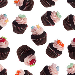 Seamless pattern of assorted mini cupcakes