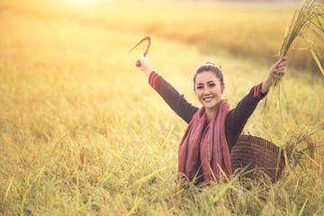 smiley beautiful of asian woman farmer in field, it's harvest time.