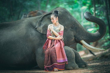 Beautiful asian girl and lovely elephant.