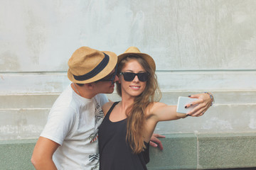 Young couple in love doing a selfie outdoors.
