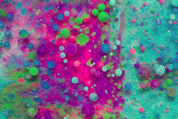 Colourful and beautiful effect of water paint and oil mixing. Multicoloured abstract bubbles.