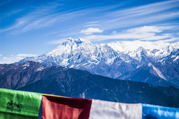 Wallpaper Macro tibetan prayer flags yellow blue red green white mountain path religion wind blue sky blur backgroun himalayan