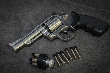 .38 revolver with ammunition and Speedloader