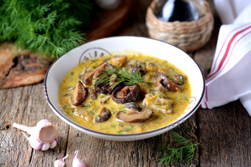 Thick soup of dried mushrooms with onions, carrots and cream.
