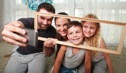 Young happy family father making selfie on smartphone at home