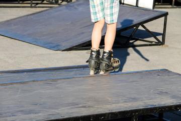 Roller skate legs closeup in skatepark