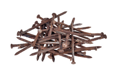 A pile of old nails on a white background